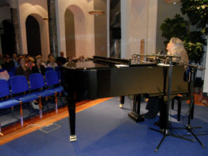 Sally Klein O'Connor at a Piano